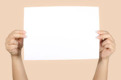 Woman's hand holding white paper Stock Photo