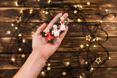 Woman`s hand holding wooden christmas toys on  background Stock Image