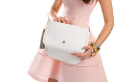Woman's hand holds white bag. Royalty Free Stock Images