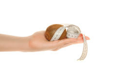 Woman's hand with kiwi and tape measure Royalty Free Stock Photography