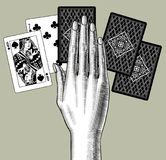 Woman`s hand laying out playing cards fan. Vintage engraving sty. Lized drawing. Vector illustration Royalty Free Stock Photos
