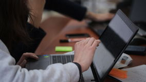 Woman's hand leading her fingers on a touchscreen laptop screen standing on table and gestures indicating that person. Next to. She is using a laptop with a stock footage