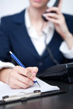Woman's hand making note Royalty Free Stock Image