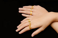 Woman`s hand with many different gold rings Royalty Free Stock Images