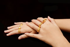 Woman& x27;s hand with many different gold rings Royalty Free Stock Photos