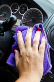 Woman's hand with microfiber cloth polishing  a car Royalty Free Stock Images