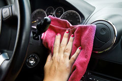 Woman's hand with microfiber cloth polishing of a car Stock Photos