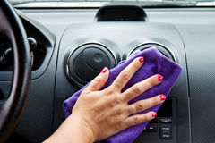 Woman's hand with microfiber cloth Stock Photos