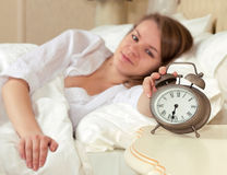 Woman's hand off the alarm clock Royalty Free Stock Image