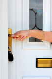 Woman's hand opening the door. Of the house Stock Images