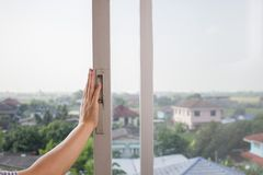 Woman`s hand opens the old sliding glass window. royalty free stock photography