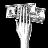 Woman`s hand palm down with a 100 dollars bank notes on black. Vintage engraving stylized drawing. Vector illustration Stock Images