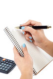 Woman's hand with a pen writing in a notebook. Royalty Free Stock Photo