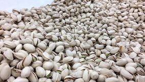 Woman`s hand picking California roasted pistachios at bulk foods section stock footage