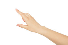 Woman`s hand pointing on object with forefinger, crop, cutout. Woman`s hand pointing on object with forefinger, close-up, cutout, isolated on white background Royalty Free Stock Photography