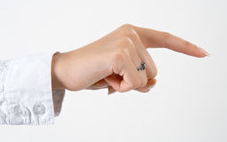 Woman's hand pointing something. Well shaped woman's hand pointing something isolated over white Stock Photo