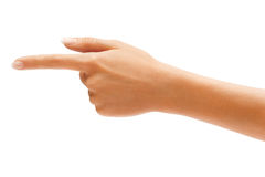 Woman's hand points a finger at something Royalty Free Stock Images