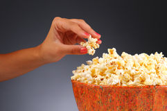 Woman's Hand and Popcorn Bowl Royalty Free Stock Photos