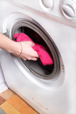 Woman's hand puts the laundry Royalty Free Stock Photos