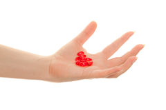 Woman's hand with  red pills Royalty Free Stock Images