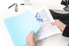 Woman's hand removing a document from a file folder Stock Photo