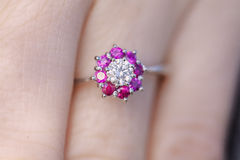 Woman's hand with a Ruby-Diamond ring. Closeup of a Hand with a Ring of Diamond and Ruby Royalty Free Stock Image