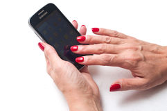 Woman's hand with a Samsung galaxy Royalty Free Stock Photography