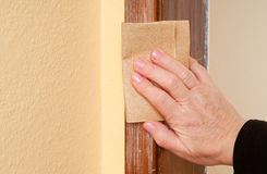 Woman's Hand Sanding Woodwork Royalty Free Stock Image