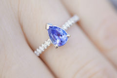Woman's hand with a Sapphire ring. Closeup of a Hand with a Ring of Sapphire Royalty Free Stock Images
