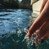 Woman`s hand in the sea. Water and drop splashing. Fethiye, Mugla, Turkey stock images