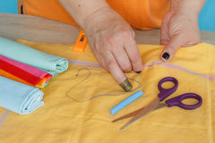 Woman`s hand sew cloth. Handmade Royalty Free Stock Photography