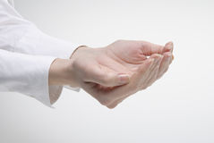 Woman's hand showing support symbol. Over light background Royalty Free Stock Image