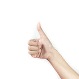 Woman's hand showing thumbs up sign against. Stock Images