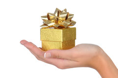 Woman's Hand With Small Gold Gift Box Royalty Free Stock Photos