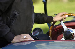 Woman's hand on the steering wheel Royalty Free Stock Photo