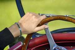Woman's hand on the steering wheel Royalty Free Stock Images