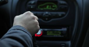 A woman`s hand switches gears in a car. Manual transmission. Shifting gear stock video footage