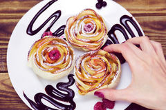 Woman`s hand take one of three apple muffins Royalty Free Stock Image