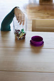 Woman's Hand Taking Candies From Jar stock photos