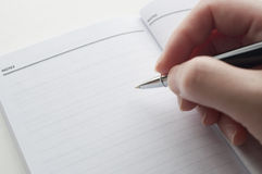 Woman's hand taking note Royalty Free Stock Images