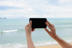 Woman 's hand taking photo with mobile phone Stock Images