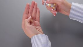 Woman's hand taking pill. stock footage
