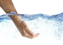Woman`s hand taking the water. Royalty Free Stock Photos