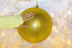 Woman`s hand to catch the Xmas ball Royalty Free Stock Photo