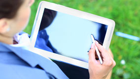 Woman's hand touching screen on modern digital tablet pc Royalty Free Stock Photos