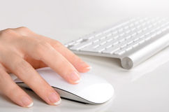 Woman's hand typing on computer keyboard Stock Photo