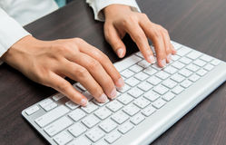 Woman's hand typing on computer keyboard Stock Photography