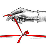 Woman`s hand untying bow of red ribbon. Vintage engraving stylized drawing. There is in addition a vector format EPS 8 Royalty Free Stock Photos