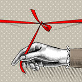 Woman`s hand untying bow of red ribbon. Vintage engraving stylized drawing. There is in addition a vector format EPS 8 Stock Photo