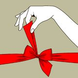 Woman`s hand untying bow of red ribbon. Vintage stylized drawing. There is in addition a vector format EPS 8 Stock Images